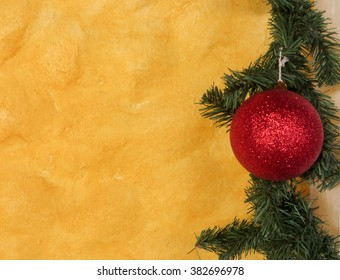 Yellow wall background with Christmas ornament