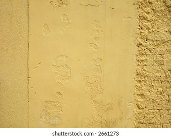 Yellow wall background with nice texture on surface