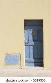 yellow wall and blue door