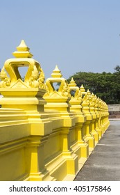 Yellow wall of the Buddhism temple, Bangkok Thailand.