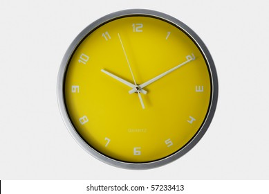 Yellow wall clock isolated with clipping path