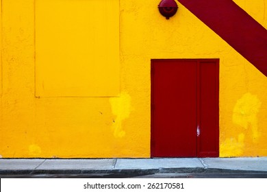 Yellow Wall with Red Door