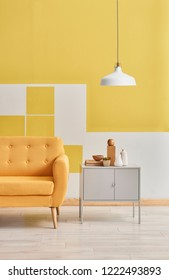 Yellow wall and sofa and grey cabinet room style. Yellow wall background and lamp style. Yellow room detail.