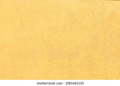 yellow wall with textured plaster