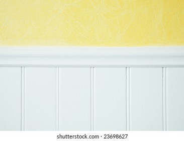 yellow wall treatment with white  wainscoting