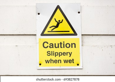 Yellow warning sign Caution Slippery When Wet