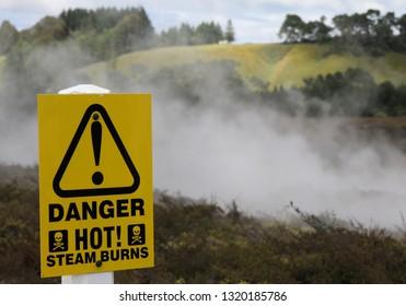 Yellow warning sign for hot steam burns at Orakei Korako Thermal Area, New Zealand