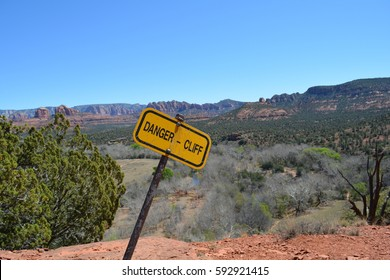 "A yellow warning sign on a hiking trail in Sedona, Arizona, in the American Southwest, that cautions travelers: ""DANGER - CLIFF"""