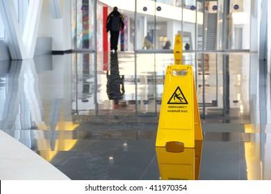 Yellow warning sign wet floor in Russian language