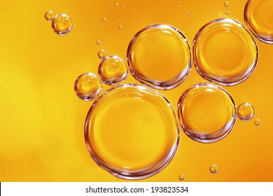 Yellow water bubbles abstract light illumination.