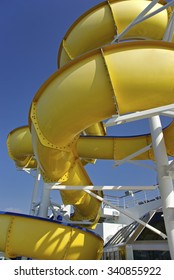 Yellow Water slide chute in an aquatic park