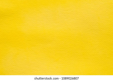 yellow watercolor color painted on paper background texture