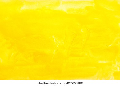 yellow watercolors on textured paper surface - design element - abstract background trend color citron fizz