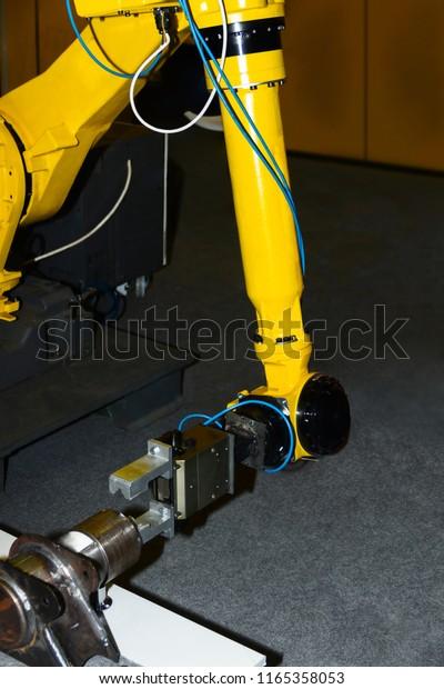 Yellow Welding Plasma Kuka Robot Hand Stock Photo (Edit Now) 1165358053
