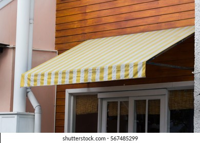 Yellow And White Awning Decor In Front Of The Shop