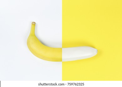 yellow and white banana on yellow and white paper, abstract concept