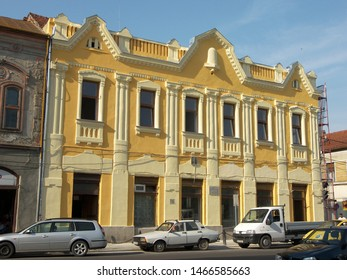 A yellow and white building with neoclassic style.