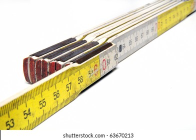 Yellow and white colored yardstick on white background
