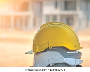 yellow and white hard safety wear helmet hat in the project at construction site