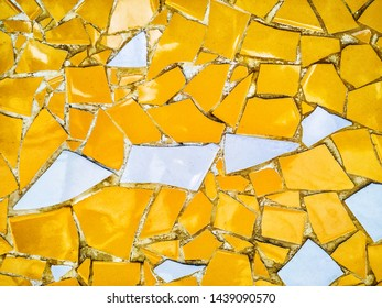 Yellow and white mosaic wall decorative ornament from ceramic broken tile.
