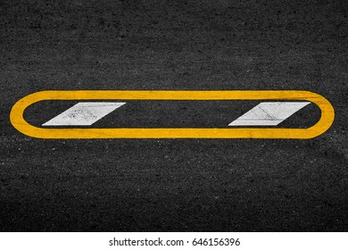 Yellow and white paint line on black asphalt. space transportation background