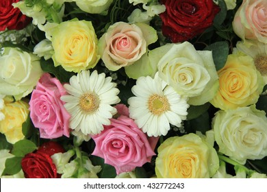 Yellow, white and pink bridal arrangement, mixed flowers