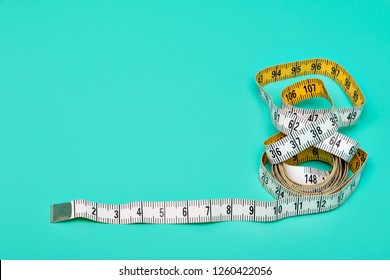 Yellow white tailor tape measure to take measurements and measure