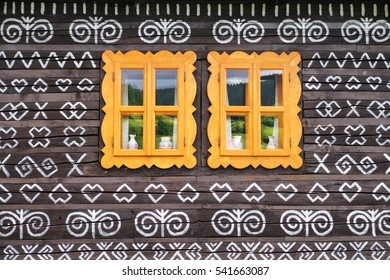 Yellow window frame on rural cottage in village Cicmany, Slovakia