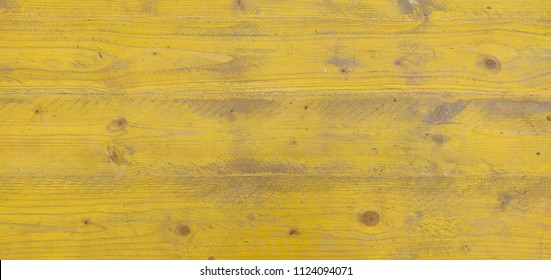 Yellow wood background.
