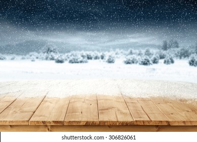 yellow wooden board place of snow