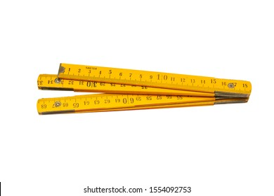 Yellow, wooden, construction ruler isolated on a white background.