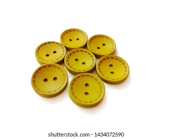 yellow wooden bottons isolated on white background