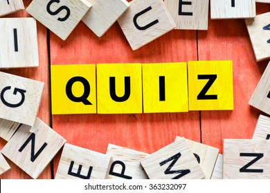 Yellow Wooden letters spelling quiz
