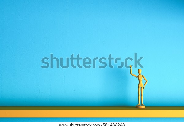 Yellow Wooden Man Presents Some Invisible Stock Photo (Edit Now