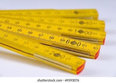 Yellow wooden ruler macro