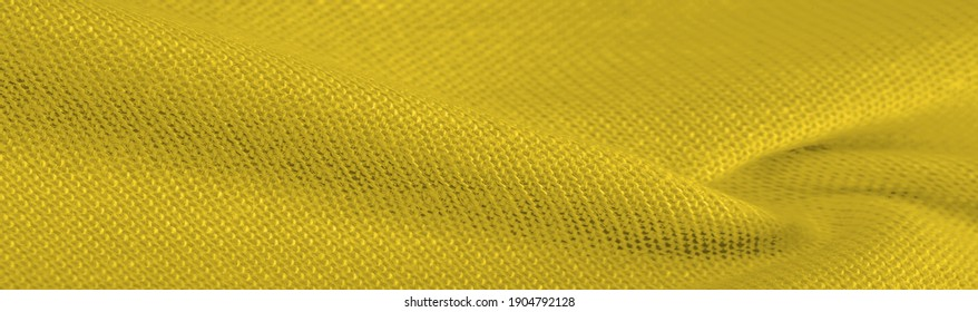 Yellow woolen fabric. Amber yellow felt texture, abstract art. Background texture, pattern