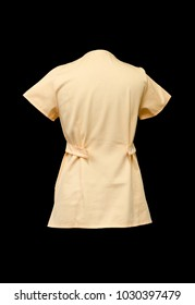yellow working cotton blouse, isolated on a black background, empty and without people