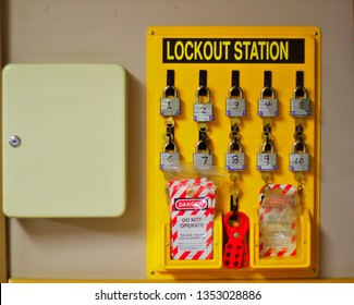 Yellow workplace lockout station with locks and tags