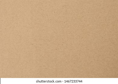 Yellow wrapping background. Brown paper texture. Beige parchment, manuscript. Natural sheet surface.