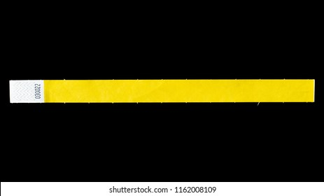Yellow wristband for events, bracelet for concerts on black background