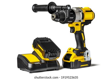 Yellow-black cordless Combi Drill Driver Hammer Drill and extra battery with charger isolated on white background.
