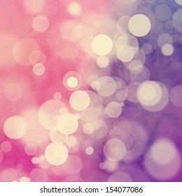 Yellowed bokeh on pink and purple background