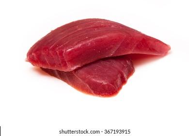 Yellowfin tuna fish steaks (thunnus albacares) isolated on a white studio background.