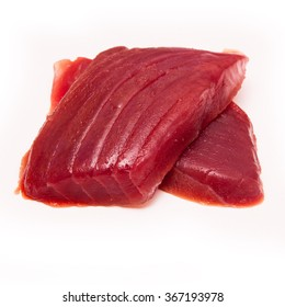 Yellowfin tuna fish steaks (thunnus albacares) isolated on a white studio background.