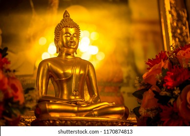 Yellow-gold Buddha and golden orange background make the Buddha look beautiful and beautiful.