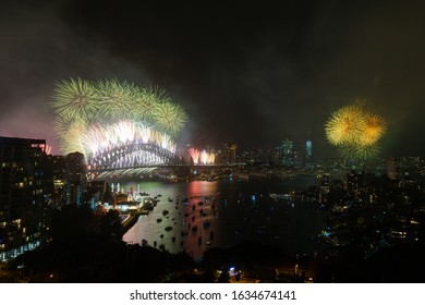 Yellow-green fireworks over Sydney Harbour.