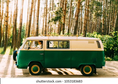 Yellow-green hippy bus with lovers rides on a forest road