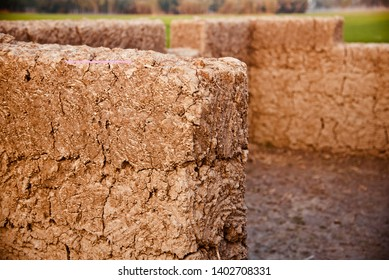 A yellowish clay made walls of an incomplete house unique photo
