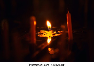 Yellow-orange candle light that resonates with water.