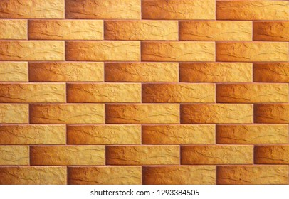Yellow-orange grunge brick texture, fireproof adobes in the wall